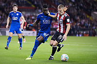 Paul Coutts of Sheffield United holds off Daniel Amartey of Leicester City during the Carabao Cup match between Sheffield United and Leicester City at Bramall Lane, Sheffield, England on 22 August 2017. Photo by James Williamson / PRiME Media Images.