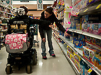 Kara directs her personal assistant, Liz, during a trip to the supermarket. Photo by James R. Evans ©