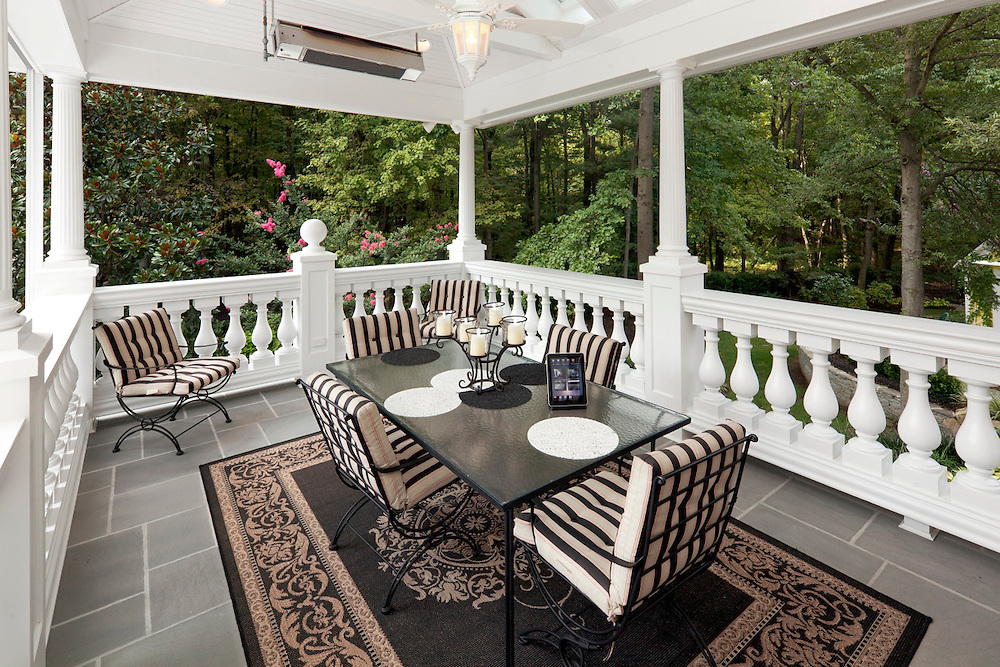 This covered patio has motorized screens that come down to keep the bugs away.