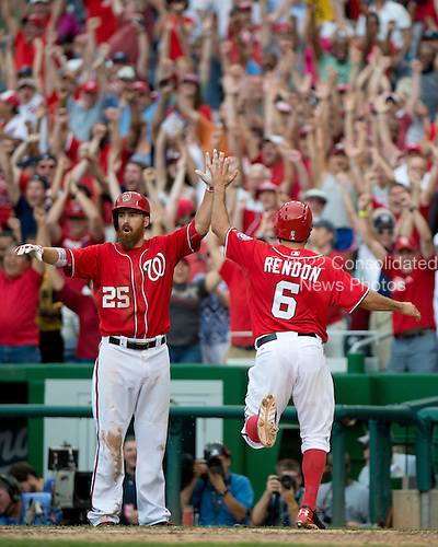 Washington Nationals third baseman Anthony Rendon (6) is congratulated by first baseman Adam LaRoche (25) after scoring the game-winning run on rightfielder Jayson Werth's (28) double in the ninth inning against the Milwaukee Brewers at Nationals Park in Washington, D.C. on Sunday, July 20, 2014.  The Nationals won the game 5 - 4.  <br /> Credit: Ron Sachs / CNP
