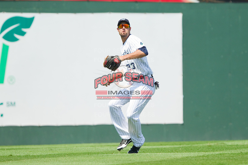 Charlotte Knights left fielder Jordan Danks (23) throws the ball back to the infield during the International League game against the Gwinnett Braves at Knights Stadium on July 28, 2013 in Fort Mill, South Carolina.  The Knights defeated the Braves 6-1.  (Brian Westerholt/Four Seam Images)