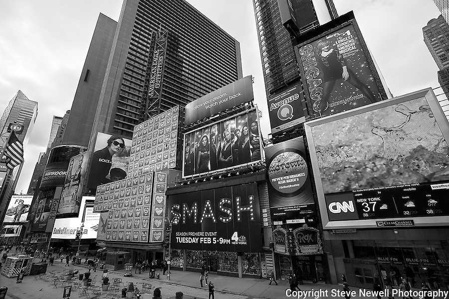 """The Roxy"" Black and White Times Square Manhattan New York. Times Square is like a little city all to itself that provides plenty of entertainment, bars, restaurants, shopping and attractions for everyone.  You can't possibly do and see it all in a one week vacation. I went to two Broadway plays and one off broadway play while I was staying in Manhattan for eight days shooting photography.  The local employees recommended their favorite restaurants and bars in the area that were excellent and affordable.  Times Square has so much to offer everyone from all walks of life will be satisfied on a visit to the must see district. I made several trips to the area spanning morning noon and night- to late night. When the huge storm blew into New York on the weekend I found myself in the middle of Times Square alone enjoying the light snow fall.  A memory I will cherish!"