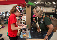 NWA Democrat-Gazette/BEN GOFF @NWABENGOFF<br /> Tabitha Crawley (left) of Maysville shows her tiger Madagascar hissing cockroaches to Helen Jackson of Bentonville Friday, Aug. 11, 2017, at the Benton County Fair in Bentonville. Crawley is studying entomology for her 4-H project, and was a state winner last year with her collection of preserved insect specimens.