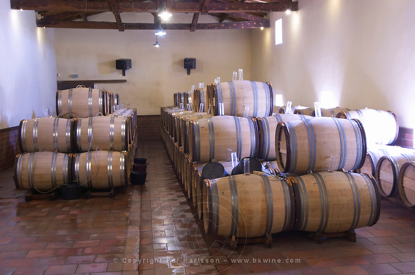 barrels with fermenting wine chateau guiraud sauternes bordeaux france