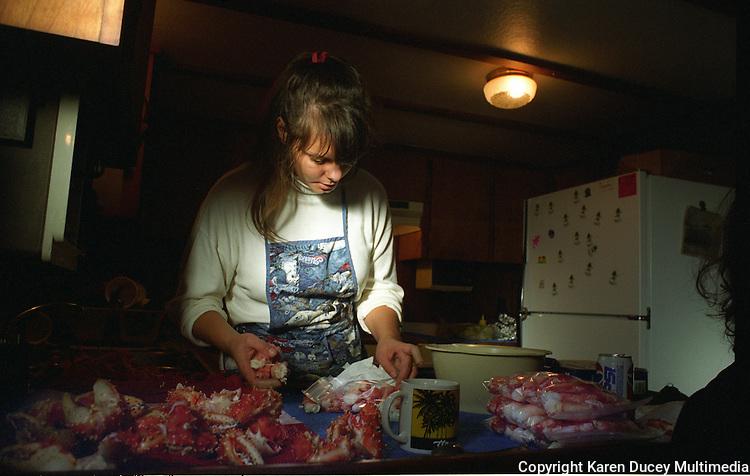 Donna Quashnick, cook on board the F/V Maverick, prepares red king crab in November 1993.