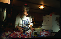 Donna Quashnick, cook on board the F/V Maverick, prepares red king crab in November 1993.