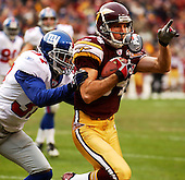 Landover, MD - December 8, 2002 -- Washington Redskin wide receiver Chris Doering (84) makes third quarter reception against New York Giants safety Johnnie Harris (37) in Landover, Maryland.  The Giants won the game 27 - 21..Credit: Ron Sachs / CNP.[NOTE: No New York Metro or other Newspapers within a 75 mile radius of New York City]