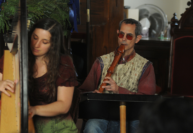 Harpist and singer, Elizabeth Clark-Jarez (left) and keyboardist, Henry Lowengard (right), performing with the Musical Group, Mamalama, at the Third Lutheran Church on Livingston Street, in Rhinebeck, NY, as part of the Rhinebeck Sinterklaas Celebration, on Saturday, December, 3, 2011. Photo by Jim Peppler. Copyright Jim Peppler/2011..