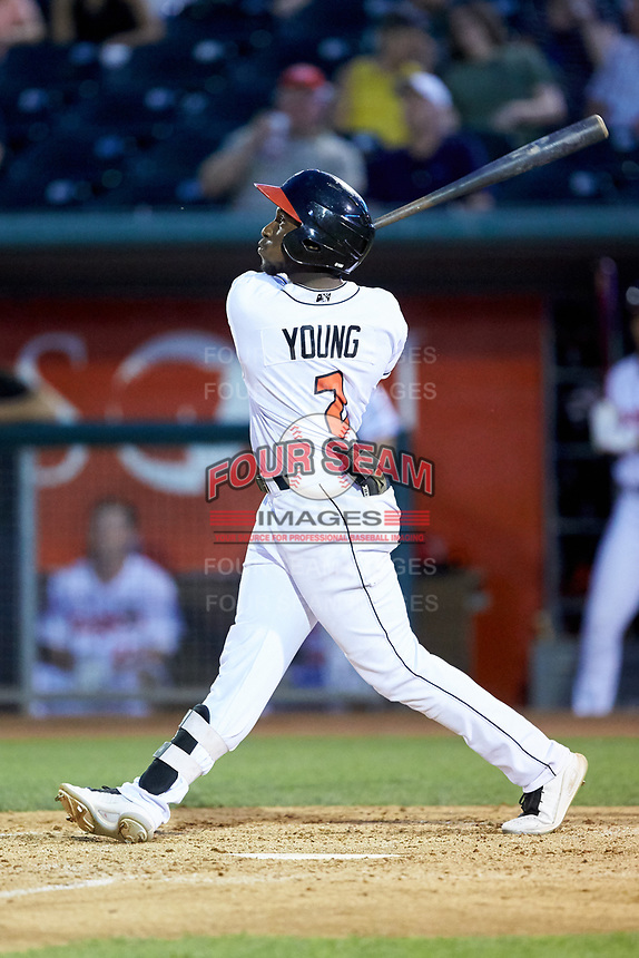 Chavez Young (2) of the Lansing Lugnuts follows through on his swing against the South Bend Cubs at Cooley Law School Stadium on June 15, 2018 in Lansing, Michigan. The Lugnuts defeated the Cubs 6-4.  (Brian Westerholt/Four Seam Images)