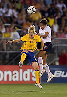 Shannon Boxx (7) of the USWNT goes up for a header against Lisa Dahlkvist (17) of Sweden at Rentschler Field in East Hartford, Connecticut.  The USWNT defeated Sweden, 3-0.