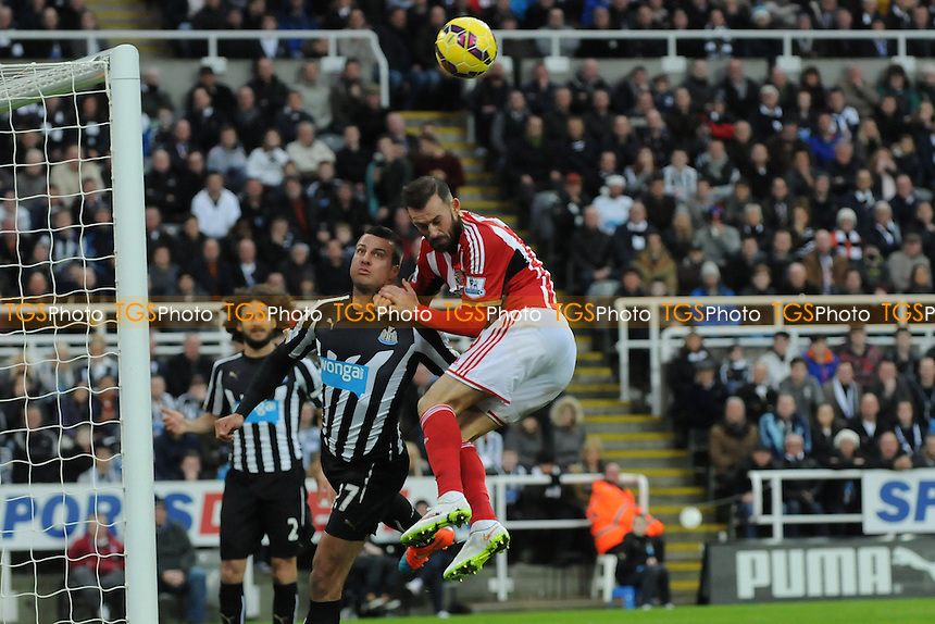 Steven Fletcher of Sunderland clashes with Steven Taylor of Newcastle United - Newcastle United vs Sunderland AFC - Barclays Premier League Football at St James Park, Newcastle upon Tyne - 21/12/14 - MANDATORY CREDIT: Steven White/TGSPHOTO - Self billing applies where appropriate - contact@tgsphoto.co.uk - NO UNPAID USE