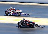 Sep 14, 2013; Charlotte, NC, USA; NHRA pro stock motorcycle rider Hector Arana (far) races alongside Andrew Hines during qualifying for the Carolina Nationals at zMax Dragway. Mandatory Credit: Mark J. Rebilas-