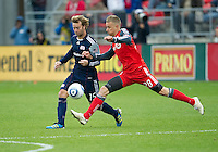 22 October 2011: New England Revolution forward Zack Schilawski #15 and Toronto FC midfielder Gianluca Zavarise #28 in action during a game between the New England Revolution and Toronto FC at BMO Field in Toronto..The game ended in a 2-2 draw.