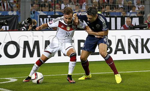 07.09.2014. Dortmund, Germany.   international match Germany Scotland  in Signal Iduna Park in Dortmund.  Germanys Mario Gotze (L) against Scotlands Russel Martin