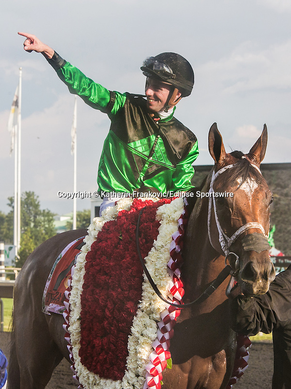 August 15, 2015. The Pizza Man and jockey Florent Geroux after winning the Arlington Million. Katherin Frankovic/ESW/CSM