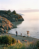 USA, Alaska, Anchorage, people enjoying and evening at Resurrection Bay next to the Scenic Hwy on the road from Anchorage to Girdwood