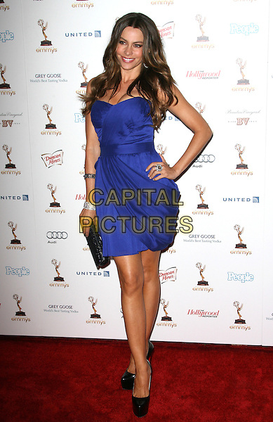 Sofia Vergara.63rd Annual Primetime Emmy Awards Cocktail Reception Honoring Nominees for Outstanding Performances held at Spectra by Wolfgang Puck inside the Pacific Design Center, Los Angeles, California, USA, September 17th 2011..full length strapless blue dress hand on hip  black platform shoes clutch bag .CAP/ADM.©AdMedia/Capital Pictures.