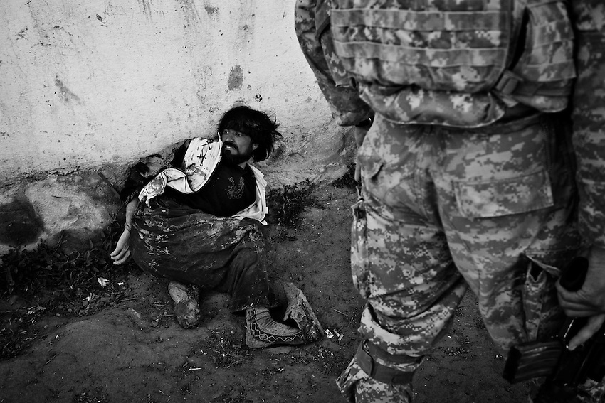 Members of Bravo Company, 1-32 Infantry, 3rd Brigade, 10th Mountain Division, detain a suspected Taliban figher after an ambush in Charkh, Afghanistan, Sunday, May 3, 2009. The 10th Mountain Division were the first arrivals of permanant reinforcements for the US military in Afghanistan when they arrived earlier this year.