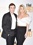 WESTWOOD, CA - APRIL 17: Daryl Sabara (L) and Meghan Trainor arrive at the Premiere Of STX Films' 'I Feel Pretty' at Westwood Village Theatre on April 17, 2018 in Westwood, California.