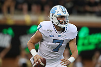 WINSTON-SALEM, NC - SEPTEMBER 13: Sam Howell #7 of the University of North Carolina scrambles with the ball during a game between University of North Carolina and Wake Forest University at BB
