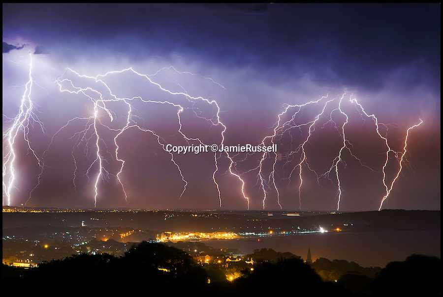BNPS.co.uk (01202 558833)<br /> Pic: JamieRussell/BNPS<br /> <br /> Shock and Awe..<br /> <br /> Amazing thunder storm captured by storm chaser Jamie Russell last night as electrical storm swept over the south coast.<br /> <br /> Intrepid Jamie was positioned on the IOW looking north east across Sandown bay to the Solent and mainland.