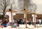 SOUTHBURY, CT- 25 MARCH 2005-032505J08---Dom Narducci, 15, of Southbury, center,  portrays Jesus being crucified on the cross along with Brendan Olena, left and Rebecca Bradshaw, right,   during the annual Good Friday Faith Walk sponsored by Southbury churches. The event, which dramatizes the Stations of the Cross, finished at the Sacred Heart Church in Southbury. -- Jim Shannon Photo--Good Friday Faith Walk; Brendan Olena; Southbury; Jesus; Dom Narducci; Rebecca Bradshaw,Sacred Heart Church  are CQ