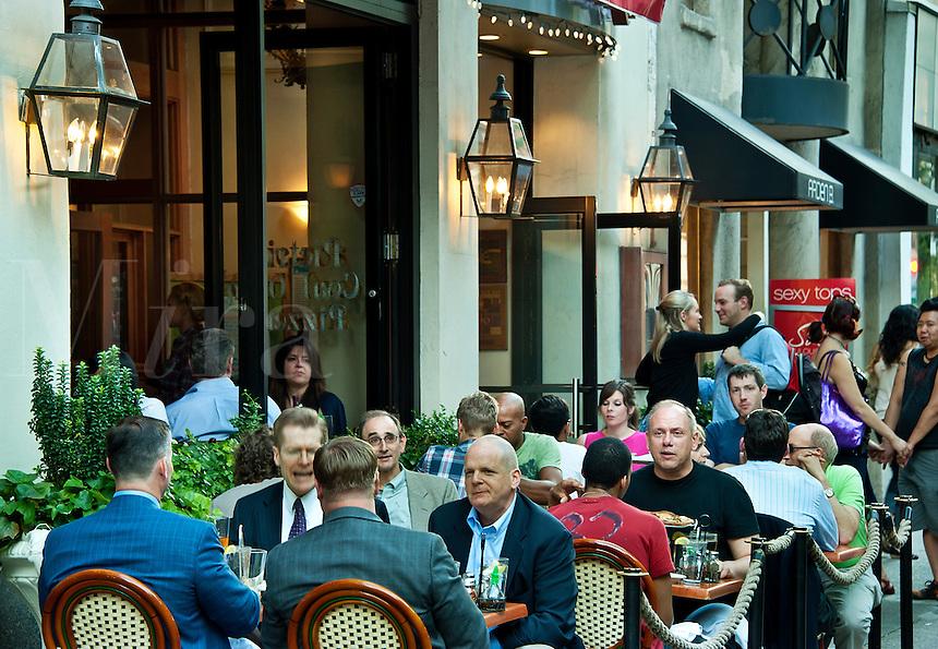 Diners enjoy sidewalk seating at a Philadelphia resaurant, Pennsylvania