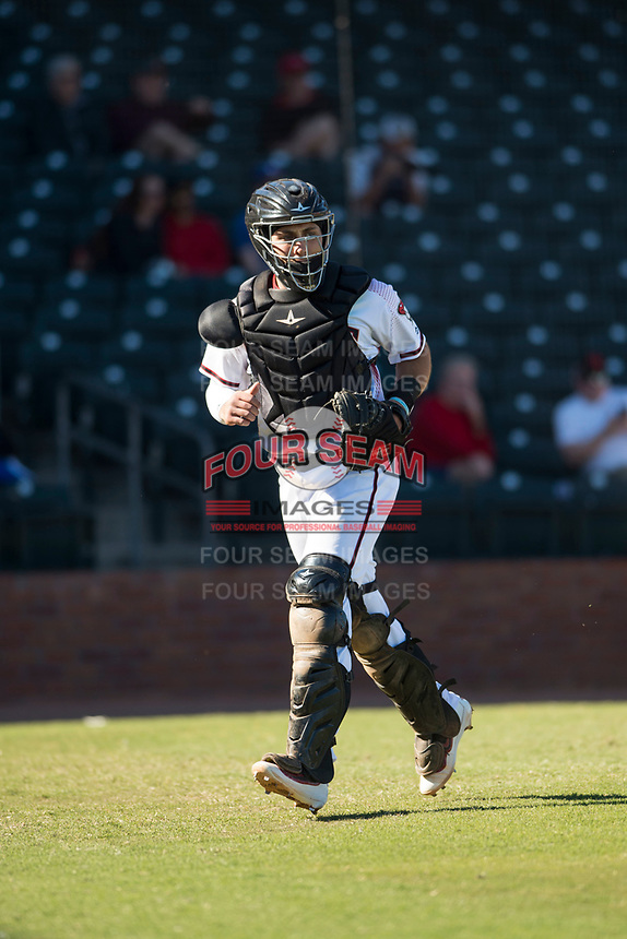 Surprise Saguaros catcher Renae Martinez (60), of the Arizona Diamondbacks organization, jogs off the field between innings of an Arizona Fall League game against the Glendale Desert Dogs at Surprise Stadium on November 13, 2018 in Surprise, Arizona. Surprise defeated Glendale 9-2. (Zachary Lucy/Four Seam Images)