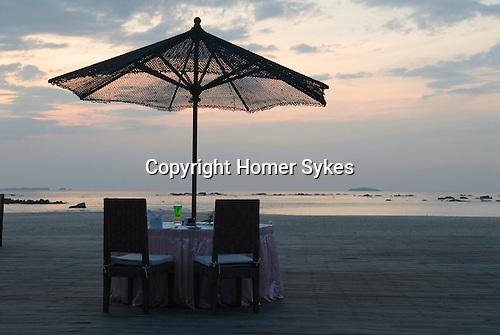 Ngwe Saung beach, Burma Myanmar 2011. Honeymoon couple's table setting.