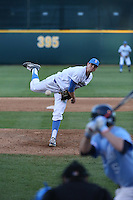 Tucker Forbes (48) of the UCLA Bruins pitches against the North Carolina Tar Heels at Jackie Robinson Stadium on February 20, 2016 in Los Angeles, California. UCLA defeated North Carolina, 6-5. (Larry Goren/Four Seam Images)
