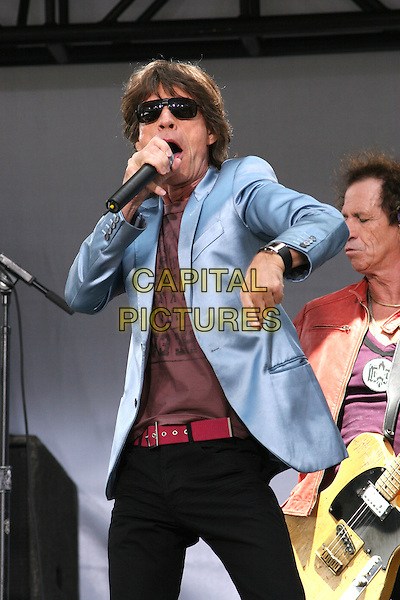 MICK JAGGER & KEITH RICHARDS.The Rolling Stones Kick Off World Tour with Surprise Performance, Julliard Music School Plaza, New York City, USA, May 10th 2005..half length concert gig funny pose arm blue jacket.Ref: IW.www.capitalpictures.com.sales@capitalpictures.com.©Ian Wilson/Capital Pictures.