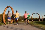 November 11, 2015. Raleigh, NC.<br /> Pat Price (yellow shirt), Keith Ferguson (grey shirt), Rob Aldina (red shirt) Anthony Greco (green shirt) and David Meeker (blue shirt) run along the North Carolina Museum of Art's greenway trails.