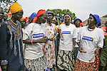 A Dinka women's folklore group speaks to the community about preventing malaria by sleeping under Serena long-lasting insecticide treated mosquito nets, which are distributed by the international NGO, Population Services International (PSI).