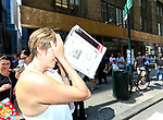 NEW YORK - AUGUST 21:  People Look Through Home Made Eclipse Viewers Made Out of Cereal Boxes As They Try and View The Full Total Eclipse On And Near 42nd Street By Grand Central August 21, 2017 in New York City.