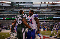 New York Jets, WR, Percy Harvin greets Buffalo Bills, LB, Larry Dean, at the end of their NFL game at MetLife Stadium in New Jersey. 09.05.2014. VIEWpress