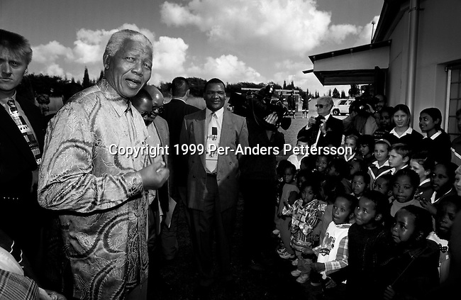 EASTCOURT, SOUTH AFRICA - MAY 1: Former President Nelson Mandela of South Africa speaks to school children during a election stop on May 1, 1999 in Eastcourt, South Africa. The ANC freedom fighter was in prison for 27 years and released in 1990. He became President of South Africa after the first multiracial democratic elections in April 1994. Mr. Mandela retired after one term in 1999 and gave the leadership to the current president Mr. Thabo Mbeki. (Photo by Per-Anders Pettersson)