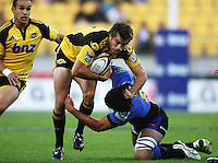 Conrad Smith tries to break out of the tackle of Force no 8 Sam Wykes. Super 14 rugby match - Hurricanes v Western Force at Westpac Stadium, Wellington. Saturday, 20 February 2010. Photo: Dave Lintott / lintottphoto.co.nz