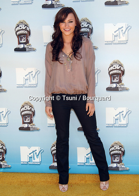 Briana Evigan    - <br /> Press room at The MTV Movie Awards 2008 at the Universal Amphitheatre in Los Angeles.<br /> <br /> full length<br /> eye contact<br /> smile