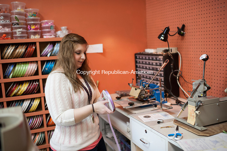 WATERBURY, CT-23 March 2015-032315EC01-   Stacey Crespo designs a ribbon at Laural Party Shop along Reidville Drive in Waterbury. Crespo's mother owns the party supply store, which is closing after 30 years. The business has been at the Reidville Drive location for 24 years. Erin Covey Republican-American