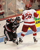 Robbie Vrolyk (NU - 91), Sahir Gill (BU - 28) - The Boston University Terriers defeated the visiting Northeastern University Huskies 5-0 on senior night Saturday, March 9, 2013, at Agganis Arena in Boston, Massachusetts.