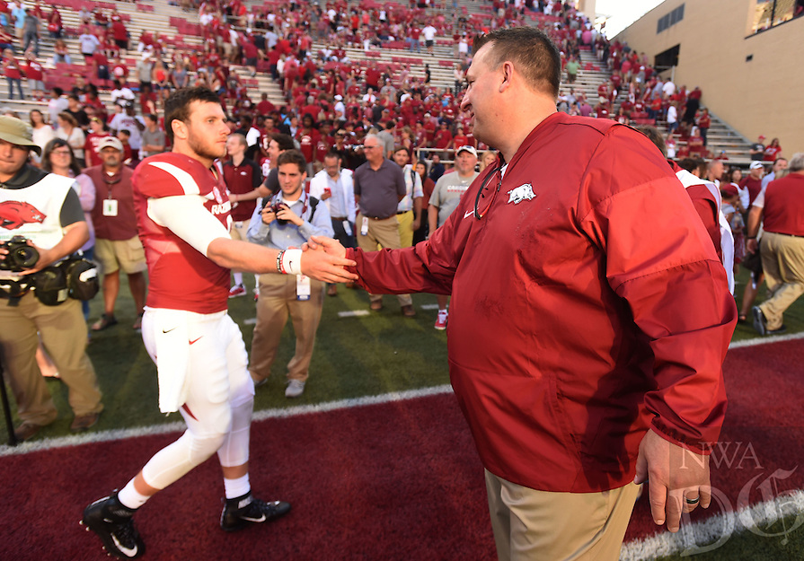 NWA Democrat-Gazette/MICHAEL WOODS &bull; @NWAMICHAELW<br /> University of Arkansas quarterback Austin Allen gets a hand shake from coach Bret Bielema after their win over Louisiana Tech Saturday, September 3, 2016 at Razorback Stadium.