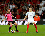 Leigh Griffiths of Scotland intercepts John Stones of England during the FIFA World Cup Qualifying Group F match at Wembley Stadium, London. Picture date: November 11th, 2016. Pic David Klein/Sportimage