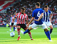 Lincoln City's Bruno Andrade vies for possession with Sheffield Wednesday's Morgan Fox<br /> <br /> Photographer Chris Vaughan/CameraSport<br /> <br /> Football Pre-Season Friendly - Lincoln City v Sheffield Wednesday - Friday 13th July 2018 - Sincil Bank - Lincoln<br /> <br /> World Copyright &copy; 2018 CameraSport. All rights reserved. 43 Linden Ave. Countesthorpe. Leicester. England. LE8 5PG - Tel: +44 (0) 116 277 4147 - admin@camerasport.com - www.camerasport.com