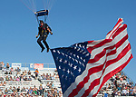 The US Navy bring in the flag during the Reno Rodeo in Reno, Nevada on Saturday, June 23, 2018.