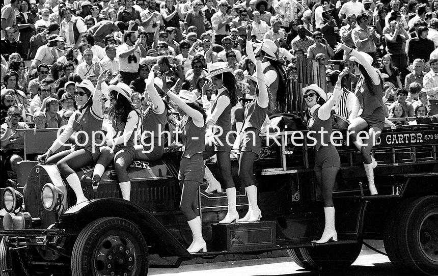 San Francisco 49er cheer squad enter in antique Red Garter fire truck..(1971 photo/Ron Riesterer)