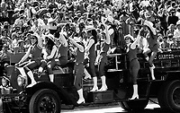 San Francisco 49er cheer squad enter in antique Red Garter fire truck..(1971 photo/Ron Riesterer)