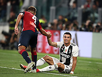 Calcio, Serie A: Juventus - Genoa, Turin, Allianz Stadium, October 20, 2018.<br /> Juventus' Cristiano Ronaldo (l) in action with Genoa's captain Domenico Criscito (r) during the Italian Serie A football match between Juventus and Genoa at Torino's Allianz stadium, October 20, 2018.<br /> UPDATE IMAGES PRESS/Isabella Bonotto