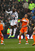 Pictured: Steven Caulker of Swansea (R) watches on as Marc-Antoine Fortune (L) of West Bromwich heads the ball away. Saturday, 04 February 2012<br />