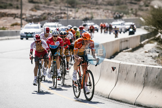 The peloton with Stijn Steels (BEL) Roompot-Charles, Darwin Atapuma (COL) Cofidis and race leader Alexey Lutsenko (KAZ) Astana Pro Team during Stage 5 of the 10th Tour of Oman 2019, running 152km from Samayil to Jabal Al Akhdhar (Green Mountain), Oman. 20th February 2019.<br /> Picture: ASO/P. Ballet | Cyclefile<br /> All photos usage must carry mandatory copyright credit (© Cyclefile | ASO/P. Ballet)