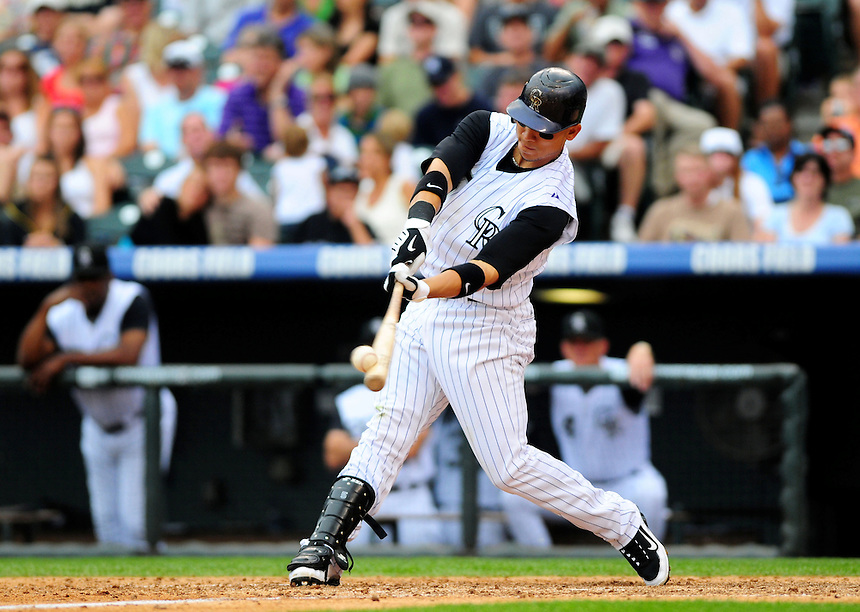 July 26, 2009: Rockies outfielder Carlos Gonzalez makes solid contact with a pitched ball during a regular season game between the San Francisco Giants and the Colorado Rockies at Coors Field in Denver, Colorado. The Rockies beat the Giants 4-2. *****For editorial use only*****